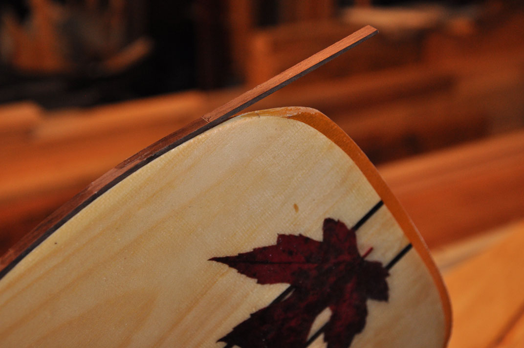 image of Walnut, white pine, and maple leaf. All possible when you build your own paddle!